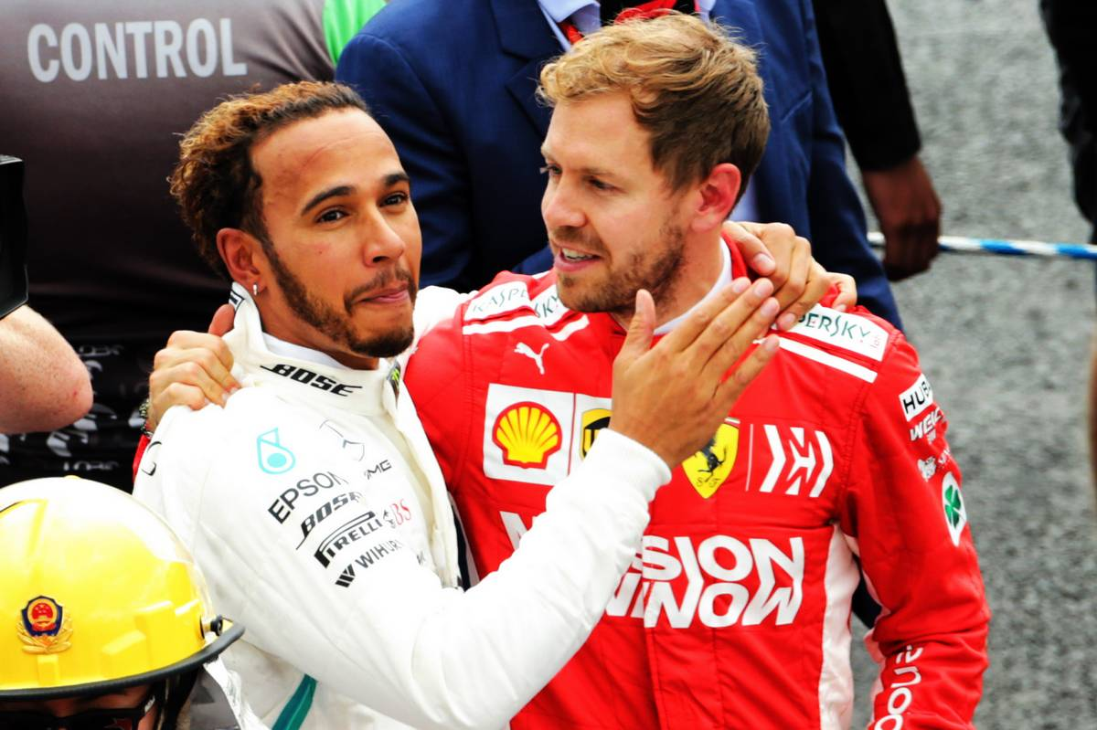 Mexican Grand Prix winner Lewis Hamilton (GBR) Mercedes AMG F1 celebrates winning the World Championship in parc ferme with Sebastian Vettel (GER) Ferrari.