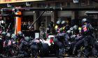 Romain Grosjean (FRA) Haas F1 Team VF-18 makes a pit stop.
