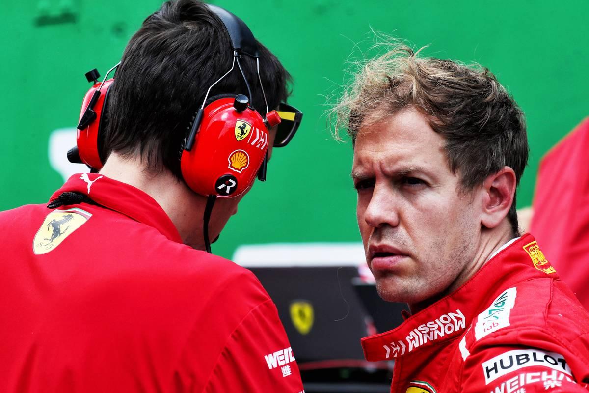 Sebastian Vettel (GER) Ferrari on the grid.