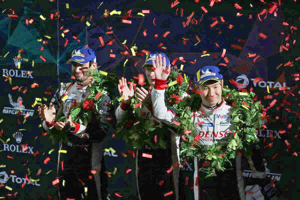 Race winners Jose Maria Lopez (ARG), Mike Conway (GBR), and Kamui Kobayashi (JPN) #07 Toyota Gazoo Racing Toyota TS050 Hybrid, celebrate on the podium.