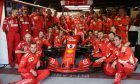 Sebastian Vettel (GER) Ferrari SF71H with his team.
