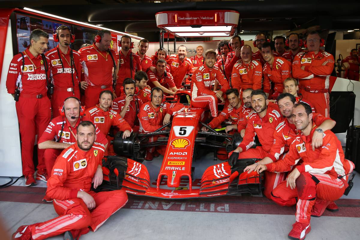 Sebastian Vettel (GER) Ferrari SF71H with his team.