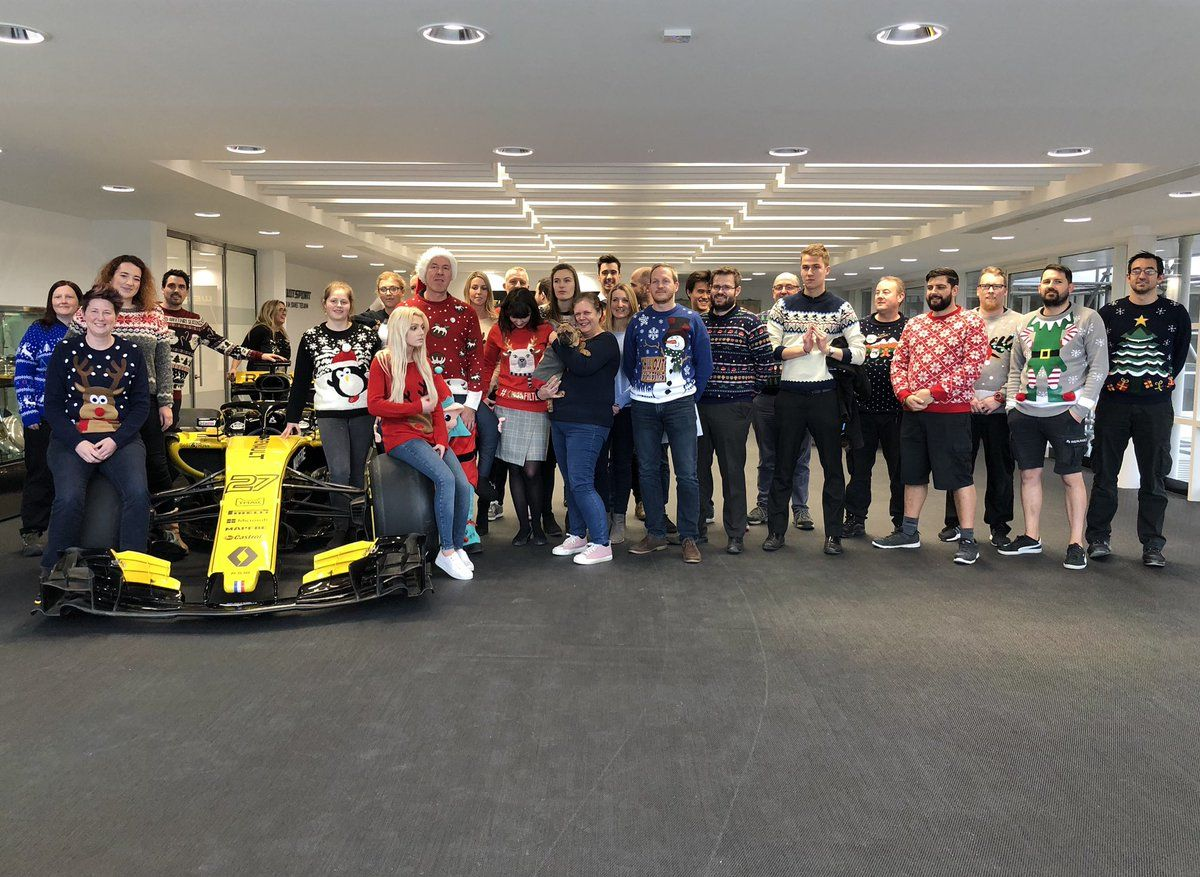 The workers at Renault's Enstone headquarters show off their seasonal knitwear for 2018 Christmas Jumper Day