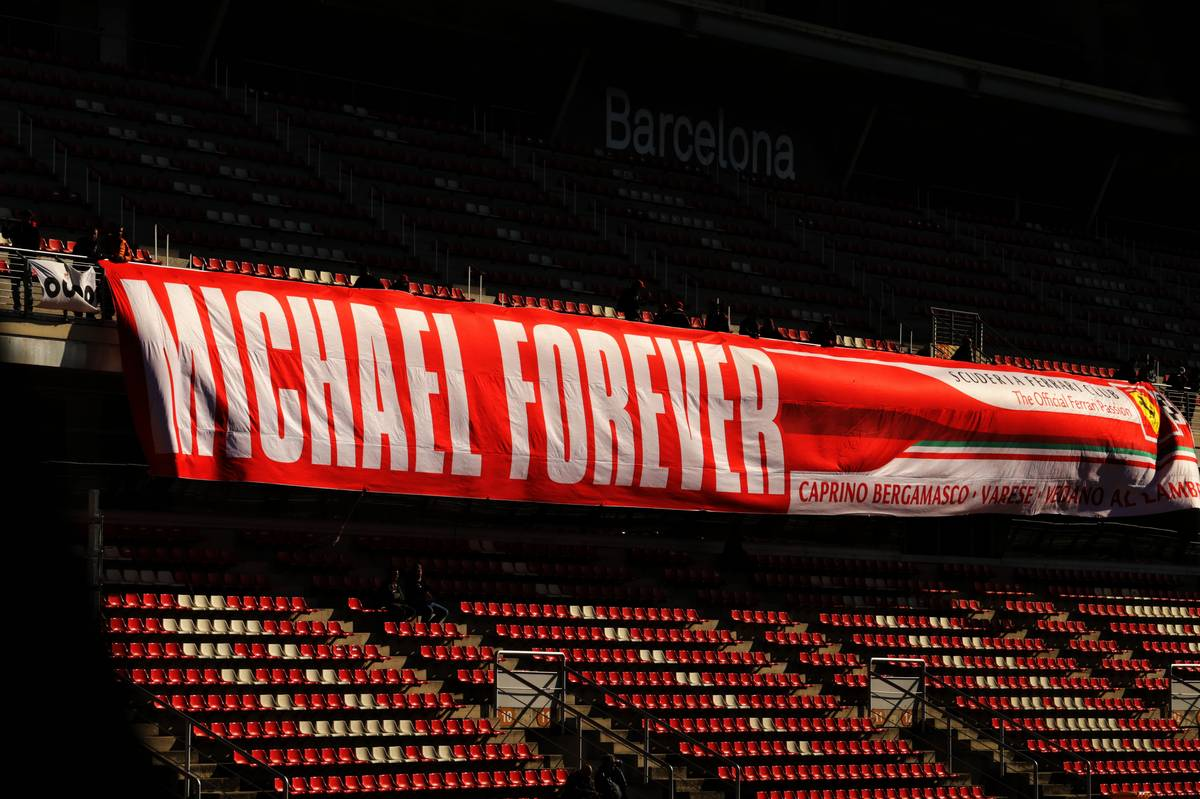 A banner for Michael Schumacher (GER) in the grandstand.
