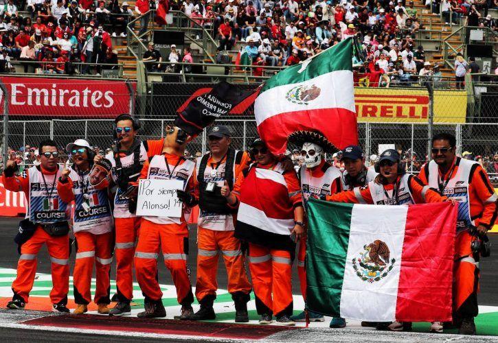 Drivers parade atmosphere - marshalls pay tribute to Fernando Alonso (ESP) McLaren.