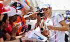 Esteban Ocon (FRA) Racing Point Force India F1 Team with fans.