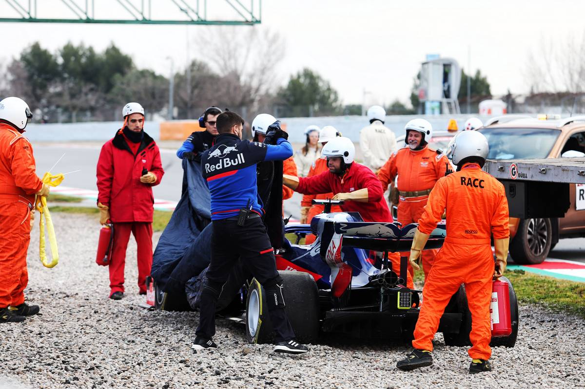 The Scuderia Toro Rosso STR14 of Alexander Albon (THA) Scuderia Toro Rosso is recovered back to the pits on the back of a truck.