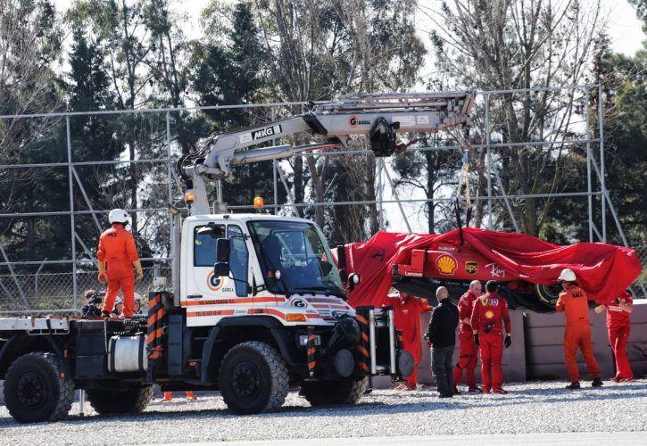The Ferrari SF90 of Sebastian Vettel (GER) Ferrari is recovered back to the pits on the back of a truck.
