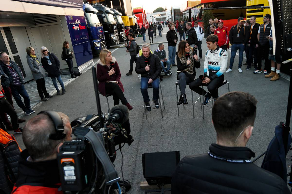 George Russell (GBR) Williams Racing with Johnny Herbert (GBR) Sky Sports F1 Presenter and Natalie Pinkham (GBR) Sky Sports Presenter.