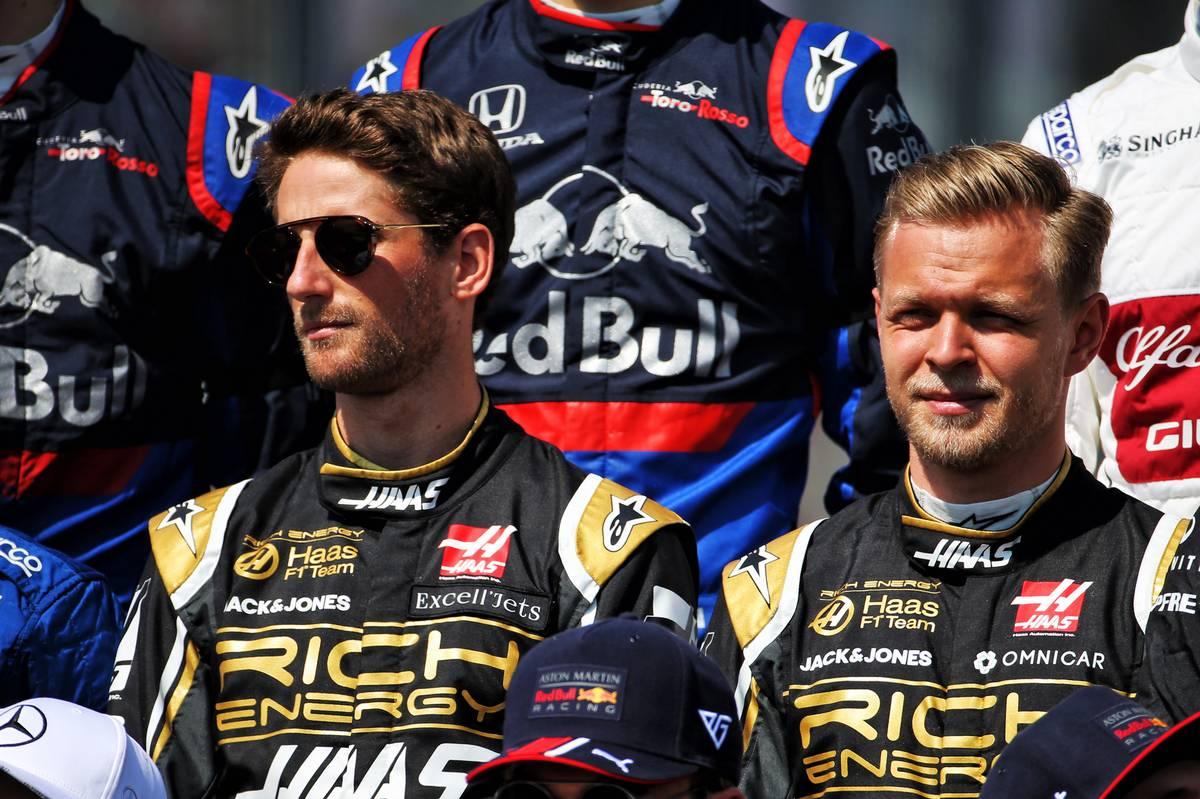 Romain Grosjean (FRA) Haas F1 Team and Kevin Magnussen (DEN) Haas F1 Team at the start of season group photograph.