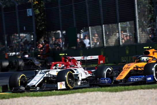 (L to R): Antonio Giovinazzi (ITA) Alfa Romeo Racing C38 and Lando Norris (GBR) McLaren MCL34 battle for position.