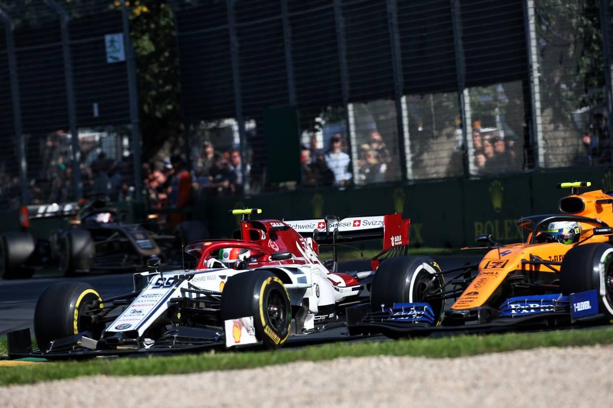Antonio Giovinazzi (ITA) Alfa Romeo Racing C38 and Lando Norris (GBR) McLaren MCL34 battle for position.