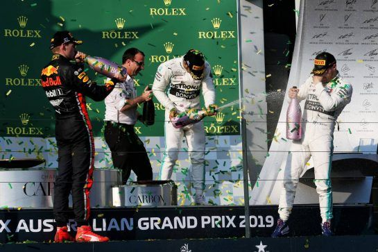 (L to R): Max Verstappen (NLD) Red Bull Racing celebrates on the podium with Lewis Hamilton (GBR) Mercedes AMG F1 and race winner Valtteri Bottas (FIN) Mercedes AMG F1.
