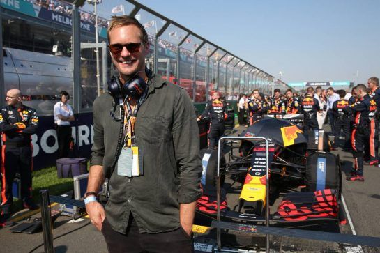 Alexander Skarsgard (SWE) Actor, with the Red Bull Racing team on the grid.