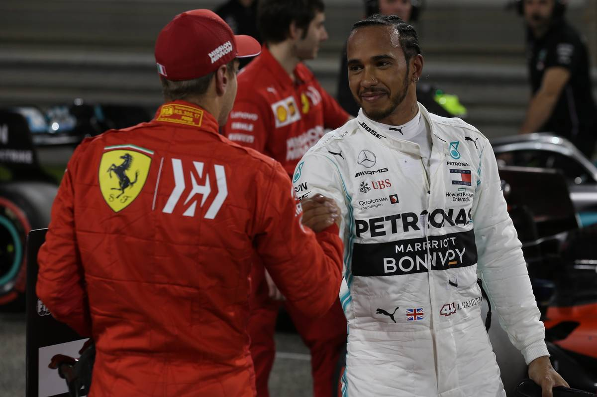 Sebastian Vettel (GER) Ferrari and Lewis Hamilton (GBR) Mercedes AMG F1.