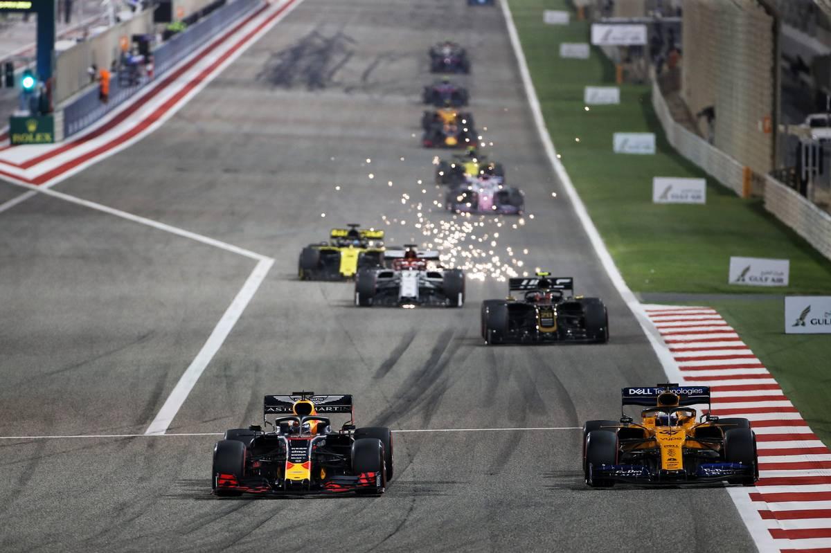 Max Verstappen (NLD) Red Bull Racing RB15 and Carlos Sainz Jr (ESP) McLaren MCL34 battle for position.