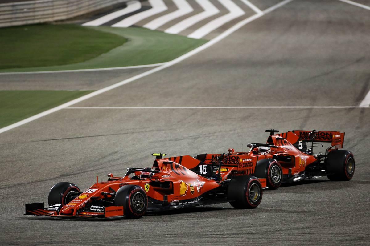 Charles Leclerc (MON) Ferrari SF90 passes team mate Sebastian Vettel (GER) Ferrari SF90.
