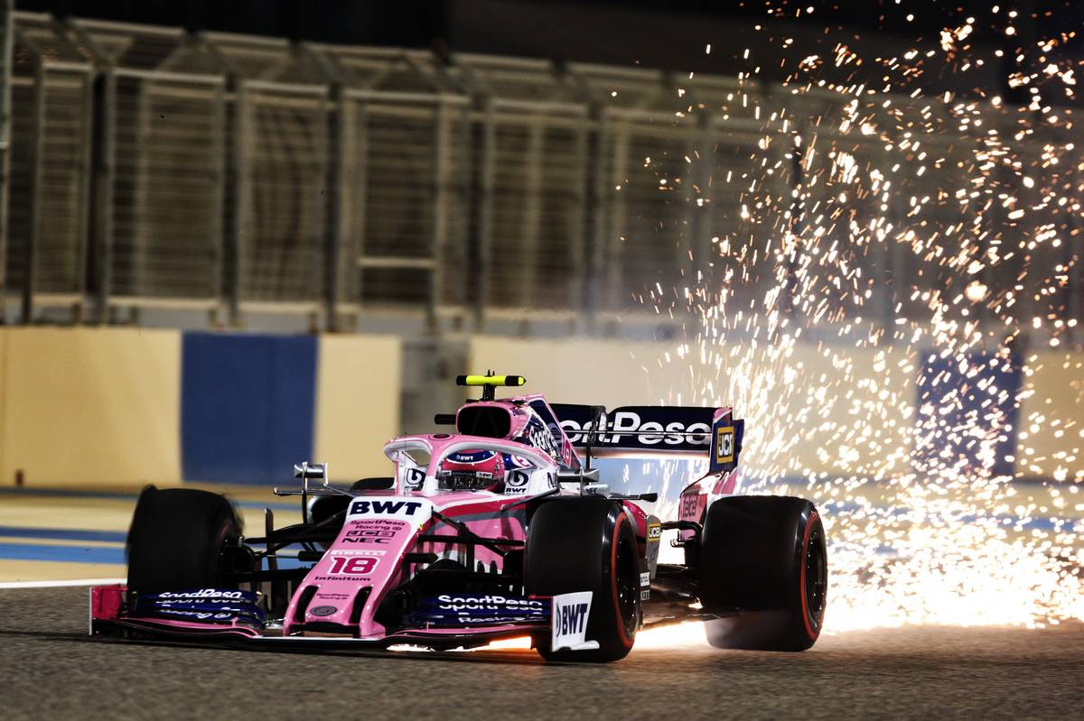 Lance Stroll (CDN) Racing Point F1 Team RP19 sends sparks flying at the start of the race.