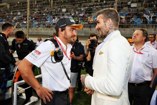 (L to R): Fernando Alonso (ESP) McLaren with David Beckham (GBR) Former Football Player on the grid.