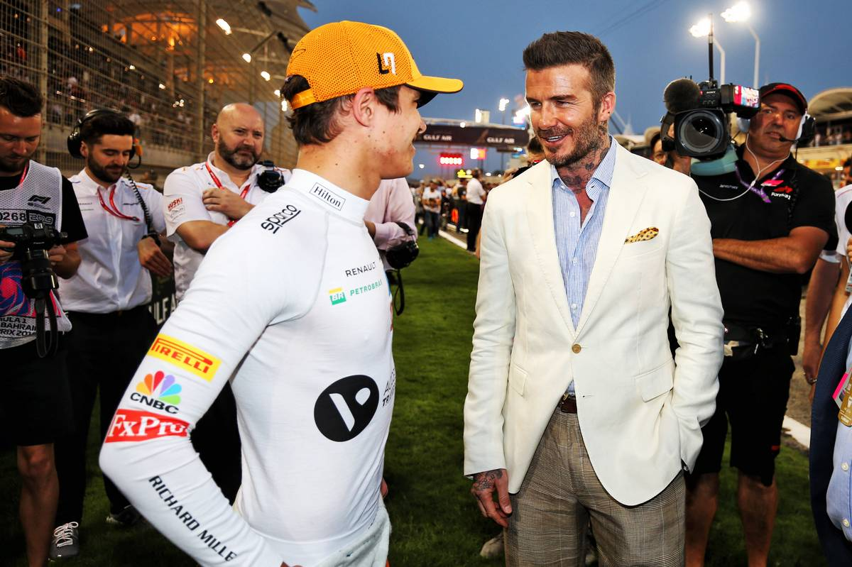Lando Norris (GBR) McLaren MCL34 with David Beckham (GBR) Former Football Player on the grid.