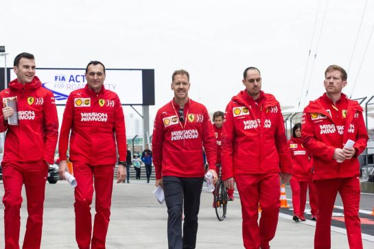 Sebastian Vettel (GER) Ferrari walks the circuit with the team. 11.04.2019. Formula 1 World Championship, Rd 3, Chinese Grand Prix, Shanghai, China, Preparation Day.  - www.xpbimages.com, EMail: requests@xpbimages.com - copy of publication required for printed pictures. Every used picture is fee-liable. © Copyright: Bearne / XPB Images
