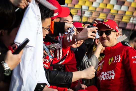 Sebastian Vettel (GER) Ferrari with fans. 11.04.2019. Formula 1 World Championship, Rd 3, Chinese Grand Prix, Shanghai, China, Preparation Day.  - www.xpbimages.com, EMail: requests@xpbimages.com - copy of publication required for printed pictures. Every used picture is fee-liable. © Copyright: Bearne / XPB Images