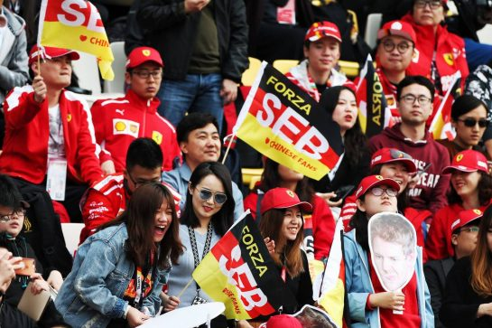 Sebastian Vettel (GER) Ferrari fans in the grandstand. 12.04.2019. Formula 1 World Championship, Rd 3, Chinese Grand Prix, Shanghai, China, Practice Day. - www.xpbimages.com, EMail: requests@xpbimages.com - copy of publication required for printed pictures. Every used picture is fee-liable. © Copyright: Moy / XPB Images