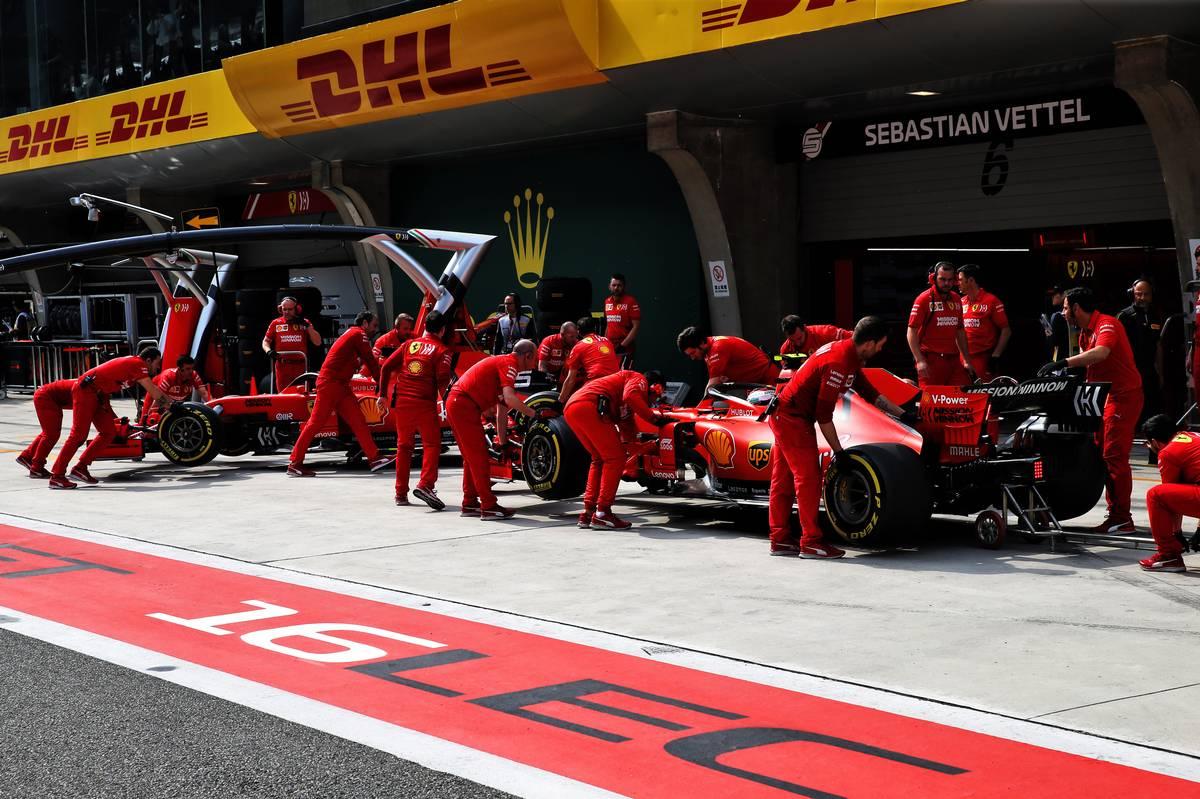 Sebastian Vettel (GER) Ferrari SF90 and Charles Leclerc (MON) Ferrari SF90 in the pits.