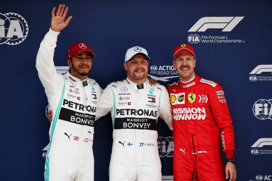 Qualifying top three in parc ferme (L to R): Lewis Hamilton (GBR) Mercedes AMG F1, second; Valtteri Bottas (FIN) Mercedes AMG F1, pole position; Sebastian Vettel (GER) Ferrari, third. 13.04.2019. Formula 1 World Championship, Rd 3, Chinese Grand Prix, Shanghai, China, Qualifying Day. - www.xpbimages.com, EMail: requests@xpbimages.com - copy of publication required for printed pictures. Every used picture is fee-liable. © Copyright: Batchelor / XPB Images