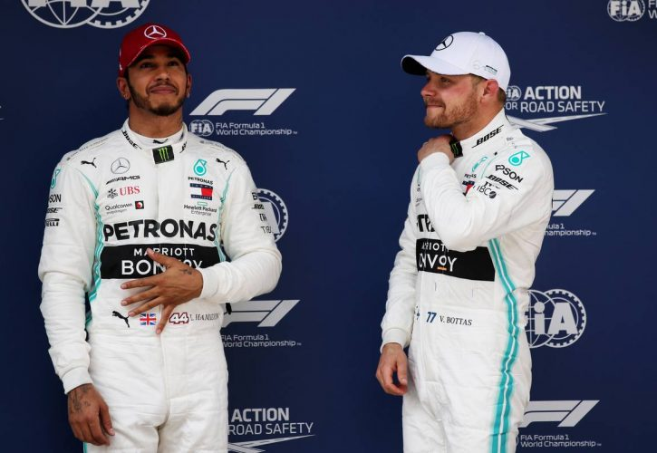Lewis Hamilton (GBR) Mercedes AMG F1 with pole sitter and team mate Valtteri Bottas (FIN) Mercedes AMG F1 in qualifying parc ferme.