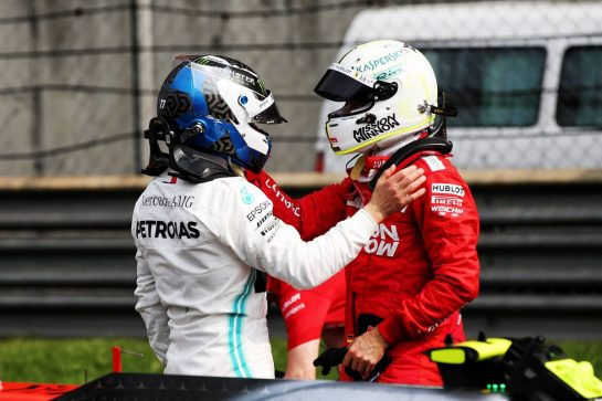 (L to R): Valtteri Bottas (FIN) Mercedes AMG F1 celebrates his pole position with third placed Sebastian Vettel (GER) Ferrari in qualifying parc ferme. 13.04.2019. Formula 1 World Championship, Rd 3, Chinese Grand Prix, Shanghai, China, Qualifying Day. - www.xpbimages.com, EMail: requests@xpbimages.com - copy of publication required for printed pictures. Every used picture is fee-liable. © Copyright: Batchelor / XPB Images