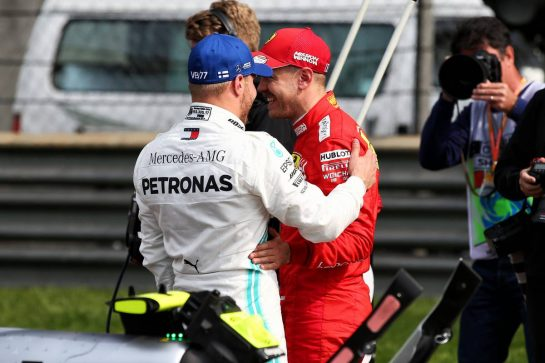 (L to R): Valtteri Bottas (FIN) Mercedes AMG F1 with Sebastian Vettel (GER) Ferrari in qualifying parc ferme. 13.04.2019. Formula 1 World Championship, Rd 3, Chinese Grand Prix, Shanghai, China, Qualifying Day. - www.xpbimages.com, EMail: requests@xpbimages.com - copy of publication required for printed pictures. Every used picture is fee-liable. © Copyright: Batchelor / XPB Images