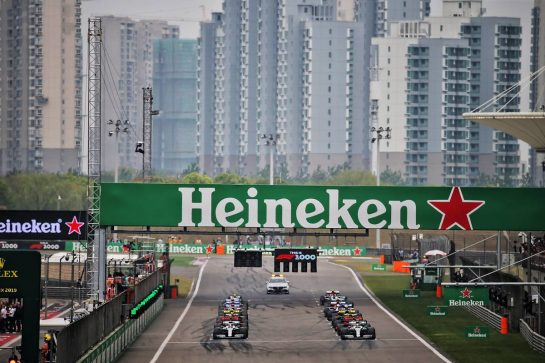 Valtteri Bottas (FIN) Mercedes AMG F1 W10 and Lewis Hamilton (GBR) Mercedes AMG F1 W10 at the front of the grid at the start of the race. 14.04.2019. Formula 1 World Championship, Rd 3, Chinese Grand Prix, Shanghai, China, Race Day. - www.xpbimages.com, EMail: requests@xpbimages.com - copy of publication required for printed pictures. Every used picture is fee-liable. © Copyright: Batchelor / XPB Images