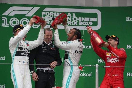 1st place Lewis Hamilton (GBR) Mercedes AMG F1 W10 2nd place Valtteri Bottas (FIN) Mercedes AMG F1 and Sebastian Vettel (GER) Ferrari SF90.14.04.2019. Formula 1 World Championship, Rd 3, Chinese Grand Prix, Shanghai, China, Race Day.- www.xpbimages.com, EMail: requests@xpbimages.com - copy of publication required for printed pictures. Every used picture is fee-liable. © Copyright: Batchelor / XPB Images