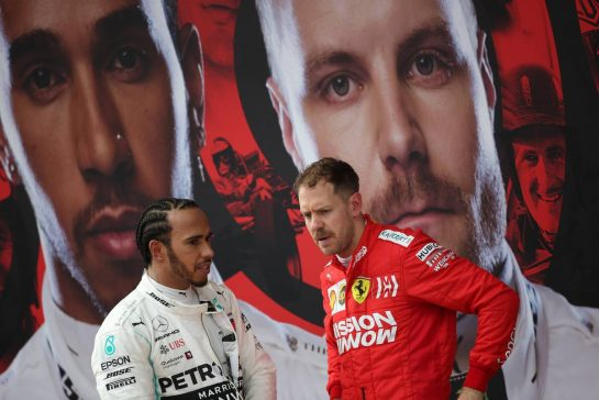 Lewis Hamilton (GBR), Mercedes AMG F1  and Sebastian Vettel (GER), Scuderia Ferrari 14.04.2019. Formula 1 World Championship, Rd 3, Chinese Grand Prix, Shanghai, China, Race Day.- www.xpbimages.com, EMail: requests@xpbimages.com - copy of publication required for printed pictures. Every used picture is fee-liable. © Copyright: Charniaux / XPB Images