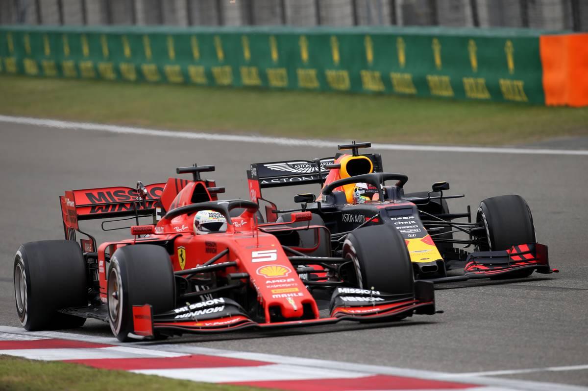 Sebastian Vettel (GER) Ferrari SF90 and Max Verstappen (NLD) Red Bull Racing RB15.