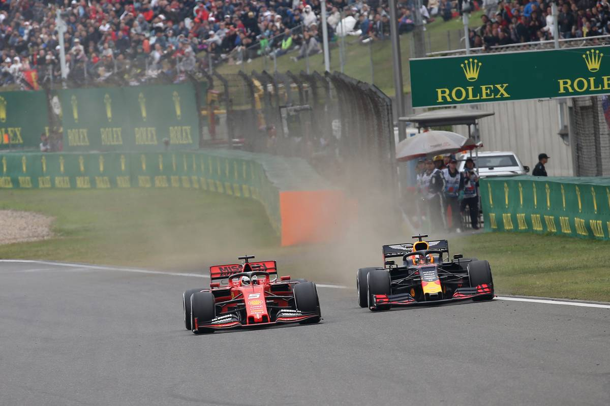 Sebastian Vettel (GER) Ferrari SF90 and Max Verstappen (NLD) Red Bull Racing RB15. 14.04.2019.