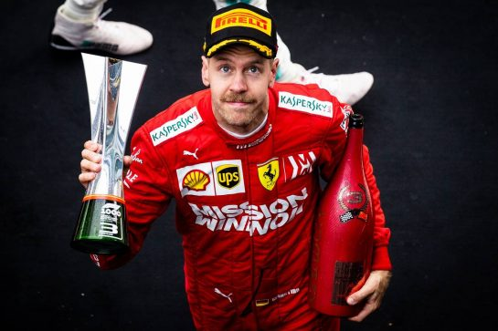 Sebastian Vettel (GER) Ferrari celebrates his third position on the podium. 14.04.2019. Formula 1 World Championship, Rd 3, Chinese Grand Prix, Shanghai, China, Race Day.  - www.xpbimages.com, EMail: requests@xpbimages.com - copy of publication required for printed pictures. Every used picture is fee-liable. © Copyright: Bearne / XPB Images