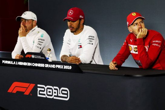 The post race FIA Press Conference (L to R): Valtteri Bottas (FIN) Mercedes AMG F1, second; Lewis Hamilton (GBR) Mercedes AMG F1, race winner; Sebastian Vettel (GER) Ferrari, third. 14.04.2019. Formula 1 World Championship, Rd 3, Chinese Grand Prix, Shanghai, China, Race Day. - www.xpbimages.com, EMail: requests@xpbimages.com - copy of publication required for printed pictures. Every used picture is fee-liable. © Copyright: Photo4 / XPB Images