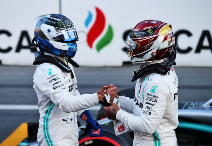 Lewis Hamilton (GBR) Mercedes AMG F1 congratulates team mate Valtteri Bottas (FIN) Mercedes AMG F1 on his pole position in qualifying parc ferme.