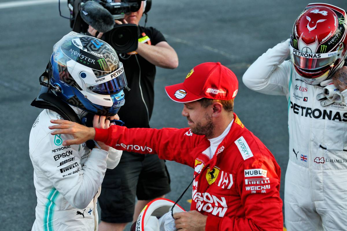 Pole sitter Valtteri Bottas (FIN) Mercedes AMG F1 with third placed Sebastian Vettel (GER) Ferrari and second placed Lewis Hamilton (GBR) Mercedes AMG F1 in qualifying parc ferme.
