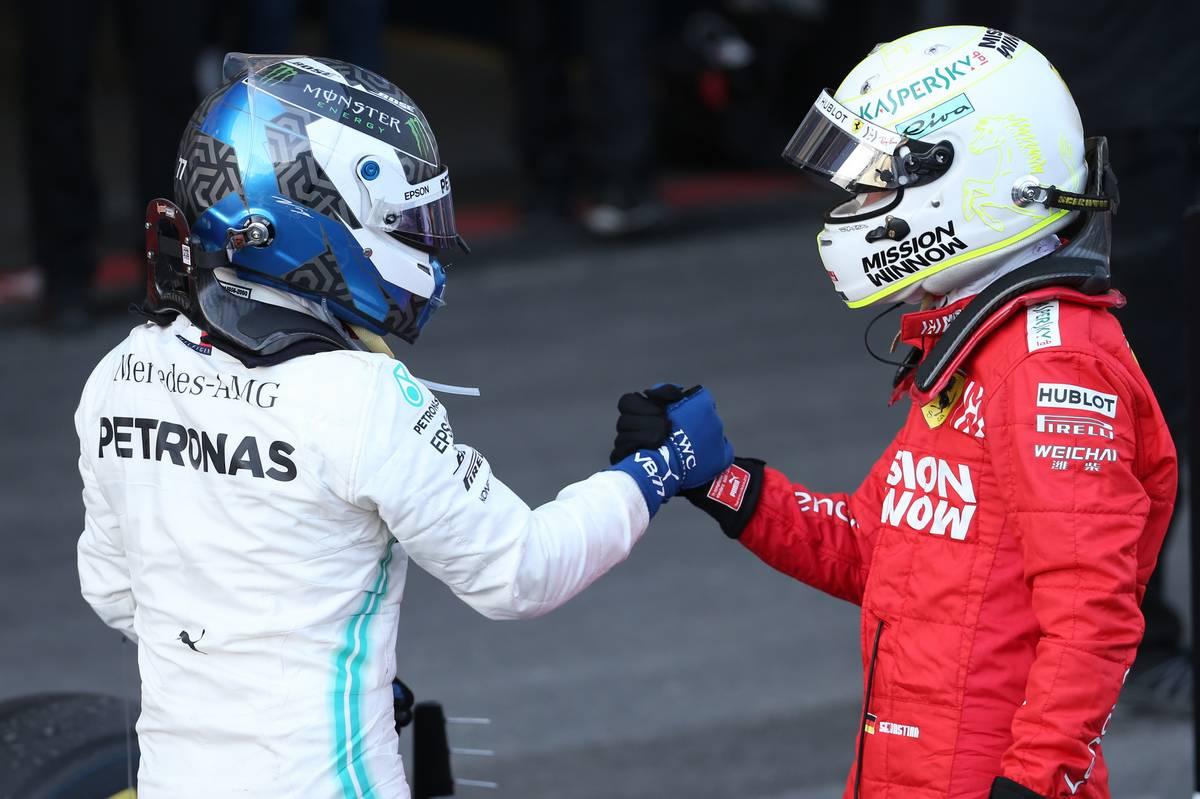 1st place Valtteri Bottas (FIN) Mercedes AMG F1 with 3rd place Sebastian Vettel (GER) Ferrari.