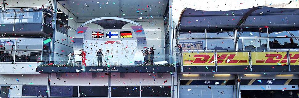 Lewis Hamilton (GBR) Mercedes AMG F1 celebrates his second position on the podium with third placed Sebastian Vettel (GER) Ferrari and race winner Valtteri Bottas (FIN) Mercedes AMG F1.