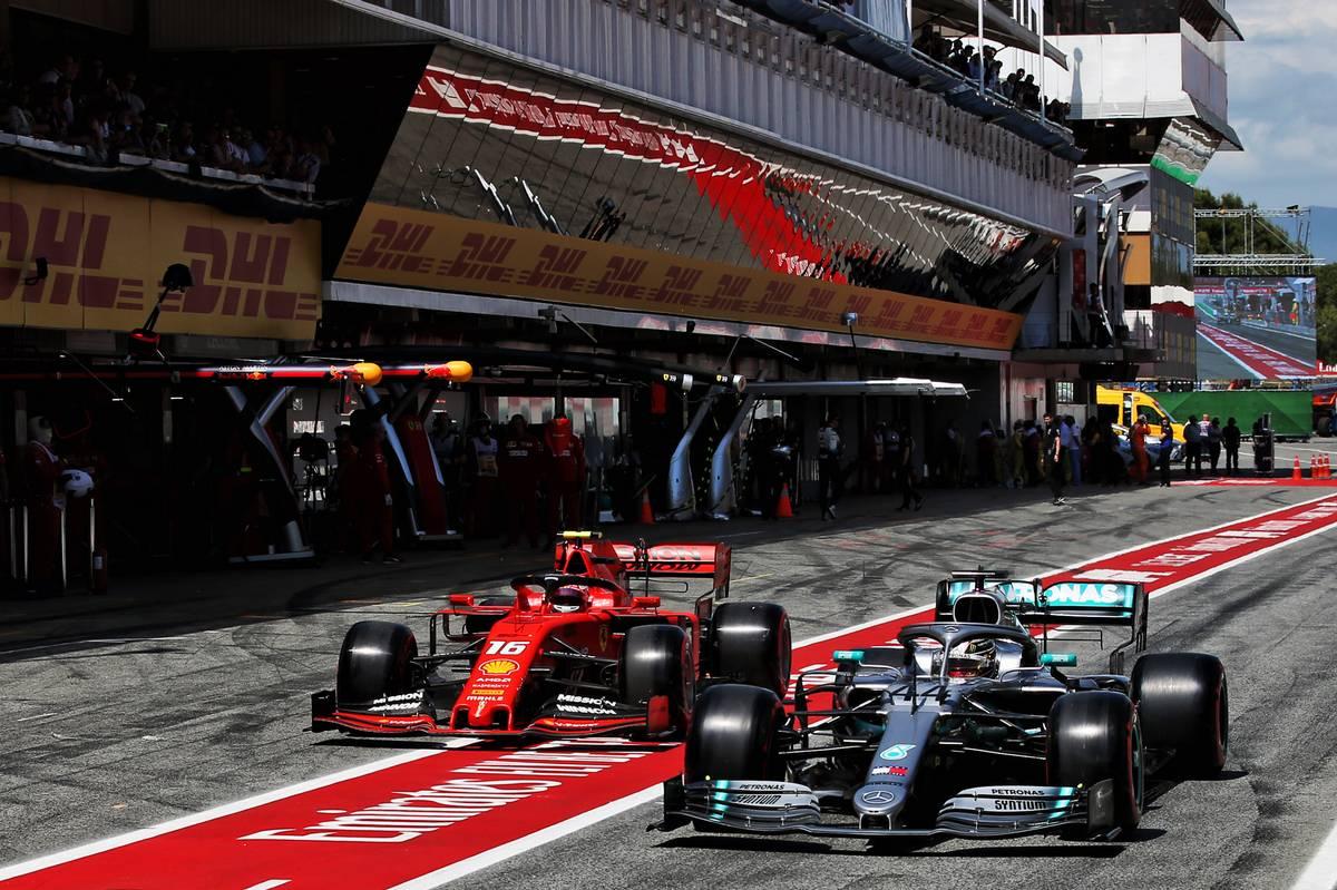 Lewis Hamilton (GBR) Mercedes AMG F1 W10 and Charles Leclerc (MON) Ferrari SF90 leave the pits.