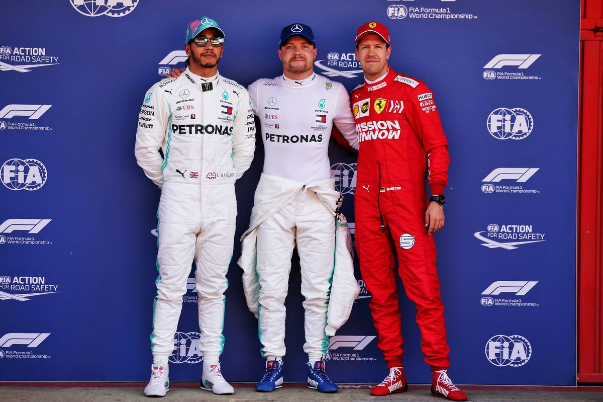 Qualifying top three in parc ferme (L to R): Lewis Hamilton (GBR) Mercedes AMG F1, second; Valtteri Bottas (FIN) Mercedes AMG F1, pole position; Sebastian Vettel (GER) Ferrari, third.