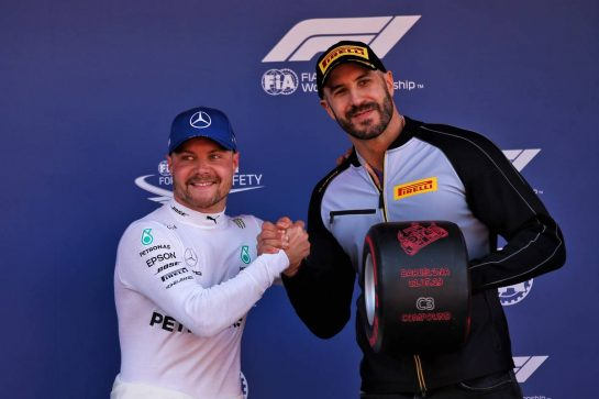 Valtteri Bottas (FIN) Mercedes AMG F1 celebrates the Pirelli Pole Position award with Claudio Castagnoli 'Cesaro' (SUI) WWE Wrestler. 11.05.2019. Formula 1 World Championship, Rd 5, Spanish Grand Prix, Barcelona, Spain, Qualifying Day. - www.xpbimages.com, EMail: requests@xpbimages.com - copy of publication required for printed pictures. Every used picture is fee-liable. © Copyright: Batchelor / XPB Images