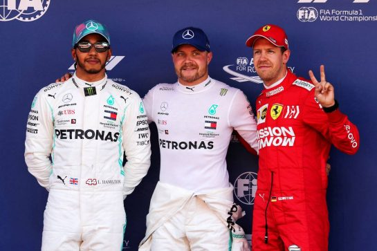 Qualifying top three in parc ferme (L to R): Lewis Hamilton (GBR) Mercedes AMG F1, second; Valtteri Bottas (FIN) Mercedes AMG F1, pole position; Sebastian Vettel (GER) Ferrari, third.