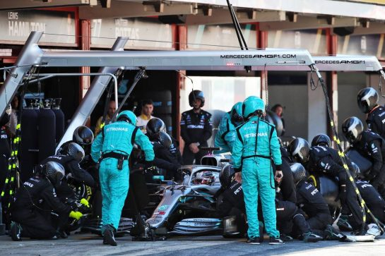 Lewis Hamilton (GBR) Mercedes AMG F1 W10 makes a pit stop.