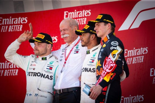 The podium (L to R): Valtteri Bottas (FIN) Mercedes AMG F1, second; Dr. Dieter Zetsche (GER) Daimler AG CEO; Lewis Hamilton (GBR) Mercedes AMG F1, race winner; Max Verstappen (NLD) Red Bull Racing, third.