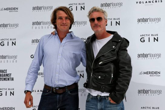 Eddie Irvine (GBR) (Right) at the Amber Lounge Fashion Show.